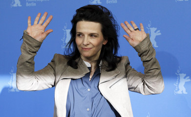 """Cast member Binoche poses during a photocall to promote the movie """"Elles"""" at the 62nd Berlinale International Film Festival in Berlin"""