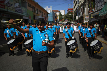 Marching band students from Ayotzinapa Teacher Training College Raul Isidro Burgos perform during a demonstration demanding justice in Chilpancingo