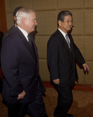 US Defense Secretary Gates and Japan's Defence Minister Kitazawa walk together as they arrive for a bilateral meeting at the Shangri-La Dialogue Asia Security Summit in Singapore