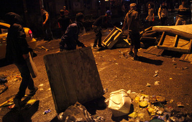 Anti-government protesters erect barricades before clashing with riot policemen during a demonstration along Kennedy street in central Ankara