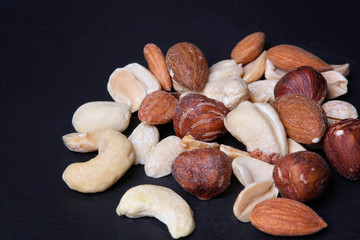 Nuts mix on black background. Close up