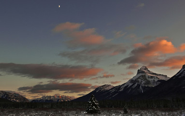 A half moon sits over Moose Meadow at sunset in Banff National Park near Lake Louise