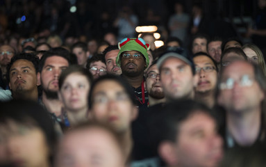 Guests watch a presentation during a Sony Computer Entertainment America media briefing before the opening day of the Electronic Entertainment Expo, or E3, in Los Angeles