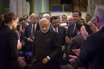 Indian Prime Minister Narendra Modi and British Prime Minister David Cameron arrive at Guildhall in London