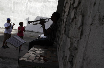 A member of the Junior Jazz band practises his trumpet at a street in a low-income neighbourhood in Santa Ana