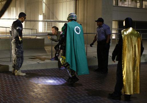 Fallen Boy, Mr. Xtreme and Vortex approach a woman during a late night patrol in San Diego, California