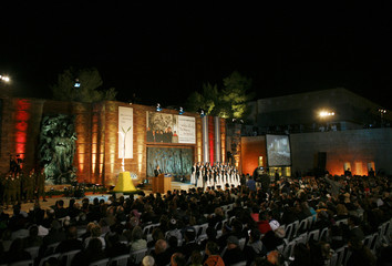 People attend the opening ceremony of the annual Holocaust Memorial Day at Yad Vashem Holocaust Memorial in Jerusalem