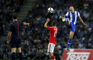 Porto's Maicon (R) fights for the ball with Benfica's Oliveira during their Portuguese premier league soccer match at Dragao stadium in Porto