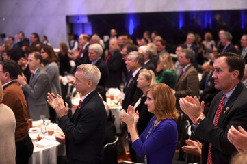 """Attendees applaud U.S. President Donald J. Trump during his speech at the 2017 """"Congress of Tomorrow"""" Joint Republican Issues Conference in Philadelphia"""