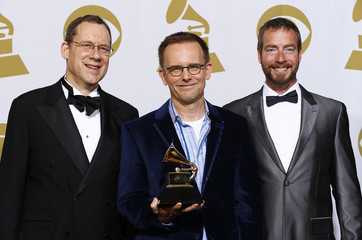 "Singers Miller and Harlan pose with Conductor Johnson and his award for best choral performance for his work on ""The Sacred Spirit Of Russia"" backstage at the 57th annual Grammy Awards in Los Angeles"