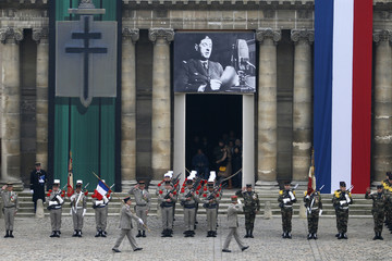 Troops salute during a ceremony at the Hotel des Invalides in Paris