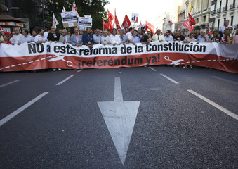 General Workers Union leader Mendez and Fernandez Toxo, leader of Comisiones Obreras march among other union members against a constitutional amendment in Madrid