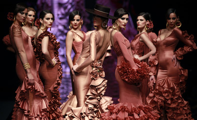 Models present creations by Vicky Martin Berrocal during the International Flamenco Fashion Show in the Andalusian capital of Seville