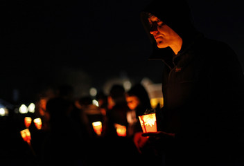 People attend candlelight vigil for Sandy Hook Elementary School shooting victims in Newtown