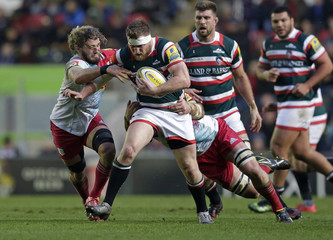 Brendon O'Connor of Leicester Tigers in action with Luke Wallace of Harlequins