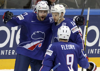 France's Da Costa celebrates his goal with team mates during their Ice Hockey World Championship game against Latvia  in Prague