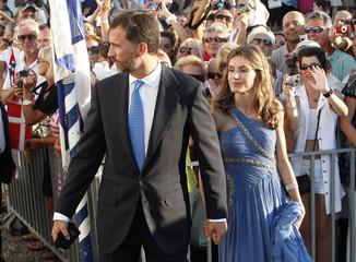 Spain's Crown Prince Felipe and Princess Letizia arrive at Agios Nikolaos church to attend wedding ceremony of Prince Nikolaos and Tatiana Blatnik on Greek island of Spetses