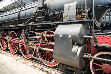 Steam locomotive standing on the platform of the station