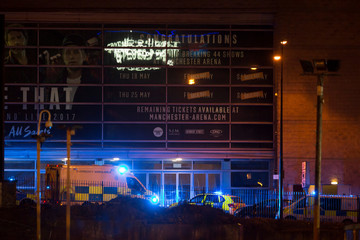 Police vans and ambulances are seen outside the Manchester Arena in northern England where U.S. singer Ariana Grande had been performing