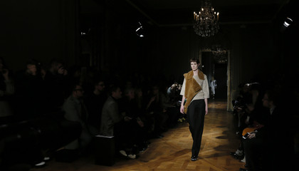 A model presents a creation by Danish designer Anne Sofie Madsen as part of her Autumn/Winter 2015/2016 women's ready-to-wear collection during Paris Fashion Week