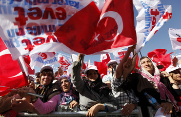 Supporters of Tayyip Erdogan attend a rally in the southeastern Turkish city of Diyarbakir
