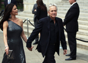 Catherine Zeta Jones and Michael Douglas arrive to attend the Vanity Fair party to begin the 2012 Tribeca Film Festival in New York
