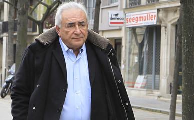 Former IMF head Strauss-Kahn  leaves his apartment in Paris