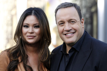 """Cast member Kevin James and his wife Steffiana De La Cruz arrive at the world premiere of the film """"Zookeeper"""" in Los Angeles"""