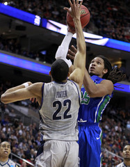 Florida Gulf Coast Eagles Sherwood Brown shoots over the Georgetown Hoyas Otto Porter Jr. during their second round NCAA tournament game in Philadelphia