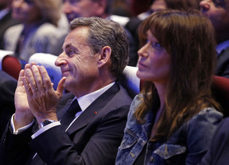 Nicolas Sarkozy former head of the Les Republicains political party applauds with his wife Carla Bruni-Sarkozy at a political rally in Toulon