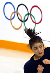 South Korea's Kim Yuna practices her routine during a figure skating training session at the Iceberg Skating Palace training arena during the 2014 Sochi Winter Olympics