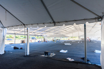 Inside large white tent for entertaining in field