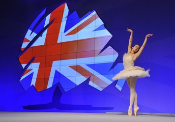 Ballerina Glurdjidze dances on stage between speakers on the second day of the Conservative Party Conference in Manchester, northern England