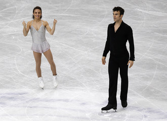 Canada's Duhamel and Radford react after competing in the pairs short program at the ISU World Figure Skating Championships in Saitama