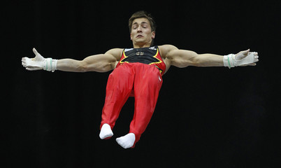 Boy of Germany performs on the horizontal bar during the men's team final of the Artistic Gymnastics World Championships in Rotterdam