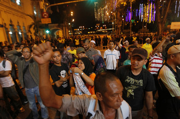 Demonstrators shout slogans during a rally at Independence Square in Kuala Lumpur
