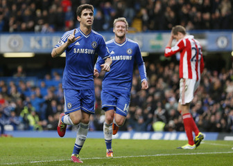 Chelsea's Oscar celebrates with Schurrle after scoring during their FA Cup soccer match against Stoke City at Stamford Bridge in Londo