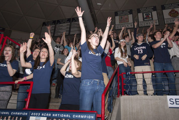 Students celebrate as they watch Connecticut Huskies play against Kentucky Wildcats in the men's final NCAA Final Four college basketball championship game in Storrs