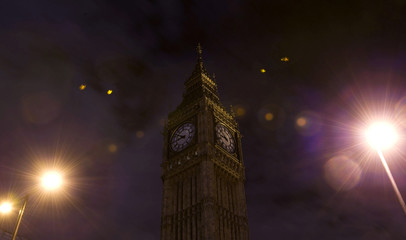 The clock tower at the Houses of Parliament is pictured with its lights extinguished during Earth hour in London