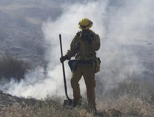 Firefighters battle the so-called Blue Cut Fire in San Bernardino County