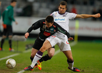 Wacker Innsbruck's Schuetz and Austria Vienna's Suttner fight for the ball during their Austrian league soccer match in Innsbruck