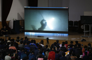 Family members of missing passengers onboard the Sewol ferry, watch an underwater video footage taken by a diver near the sunken ship, at a gym in Jindo