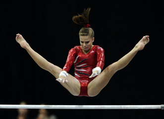 Caquatto of the U.S. performs on the uneven bars during the women's team final of the Artistic Gymnastics World Championships in Rotterdam