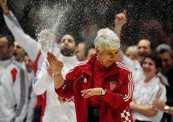 Croatia's PM Kosor celebrates with the Croatian team who won the silver medal at the Men's European Handball Championship in Vienna