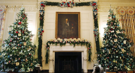 Scrabble pieces make up the words Winter Wonderland under a painting of Abraham Lincoln in the State Dining Room of the White House in Washington