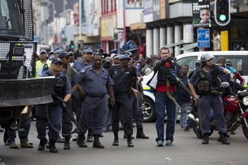 Police disperse a group of foreign nationals after a peace march in Durban