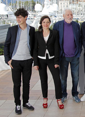 "Cast members Basile Meilleurat Laure Calamy and Christian Bouillette pose during a photocall for the film ""Rester vertical"" in competition during the 69th Cannes Film Festival in Cannes"
