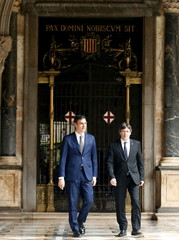 Catalunya's President Carles Puigdemont and Spain's Socialist Party leader Pedro Sanchez walk to a meeting at Palau de la Generalitat in Barcelona