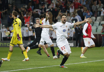 Sevilla's Coke celebrates with team-mates after defeating Benfica in their Europa League final soccer match at the Juventus stadium in Turin