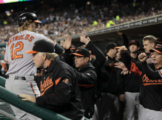 Baltimore Orioles Mark Reynolds is congratulated after hitting a home run